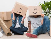 Couple having fun while moving home
